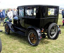 The Ford Model T (aka the Tin Lizzie, T‑Model Ford, or T) is an automobile that was produced by Henry Ford's Ford Motor Company from Sept 1908 to October 1927.