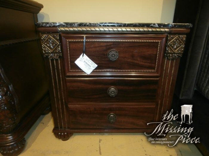 Ashley Furniture's two drawer nightstand from their Gabriella Collection. Measures 26*17*26. Two in store at time of posting.