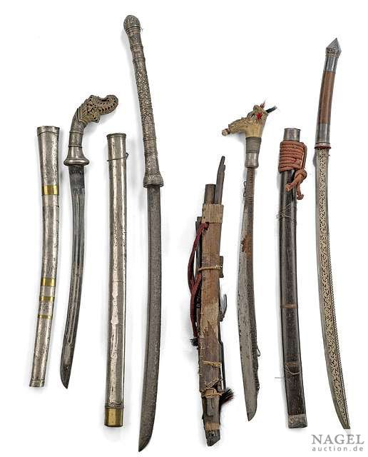 Four swords, Southeast Asia: two Dao (a chinese swordtyp, one with fine worked blade), one Mandau (sword of the head hunter dayak people) with bone hilt and one sword with partially silver covered and fine carved bone hilt. Some scabbards with damages, signs of use and aging. From an old South German private collection.