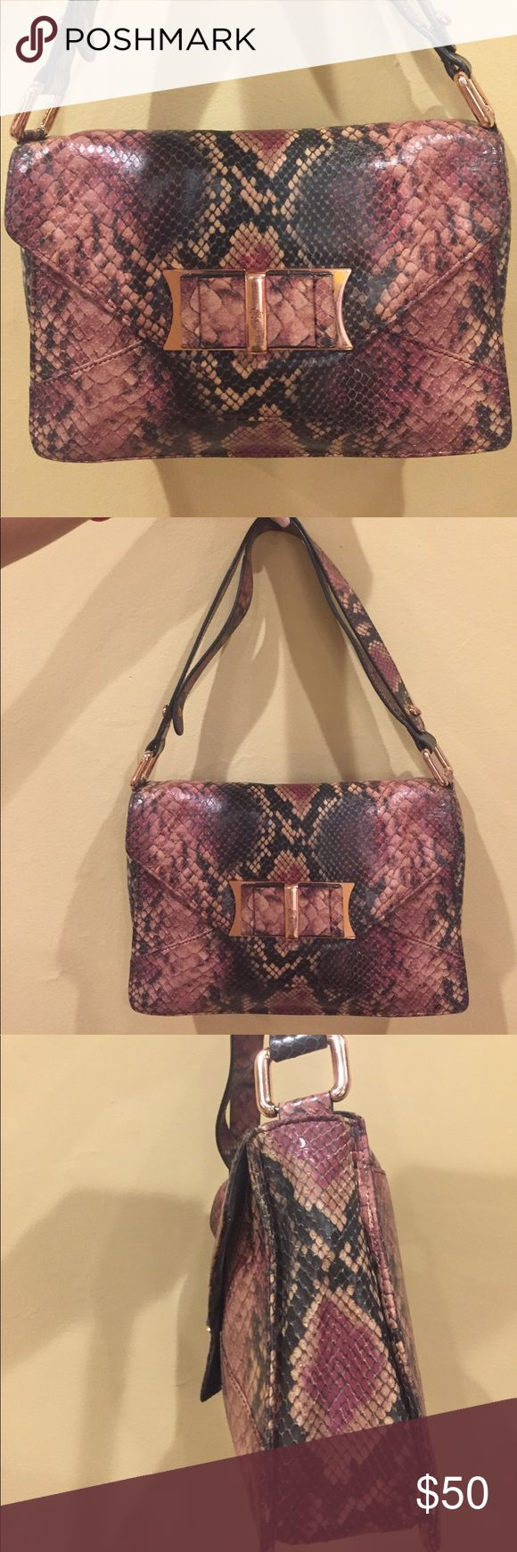 Ted baker rattle snake purse with strap Ted baker rattle snake purse with strap. Zipper inside bag. Magnetic snap. Excellent condition! Ted Baker Bags Shoulder Bags