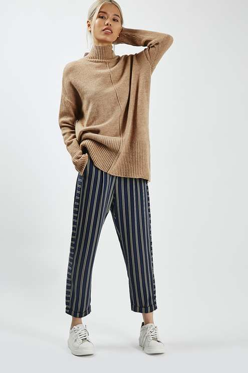 Take notes from the boys with these mensy-fit trousers. A relaxed silhouette with a focus on the cropped leg, they feature horizontal side stripe detail and rolled hems. #Topshop