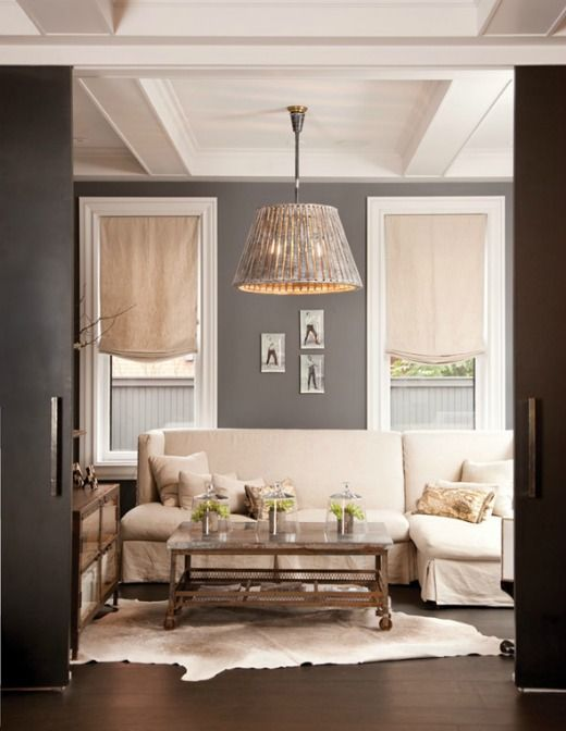 Wish I'd gone a shade or two darker on my living room walls... loving this gray.
