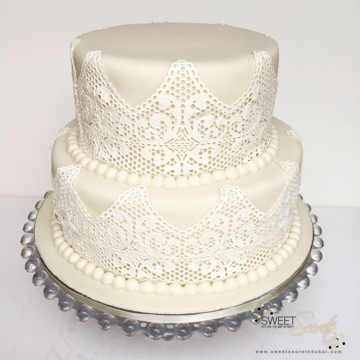 2 Tier Vanilla Wedding Cake with hand made lace fondant detail. Sweet Secrets…