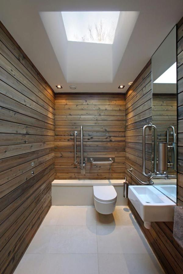 Small bathroom - Universal Design: love the skinny sink and several grab bars; skylight and low mirror are great. It would be cool if the the wood panels were tile, then add a shower head and drain. Wouldn't need a stall!