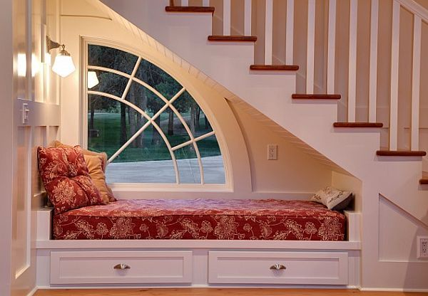Under Staircase Reading Nook Idea by Architect Jon R. Sayler, The half arch window is great!