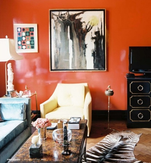 love the wall color, looks classy with black furniture and a strong pattern on the textiles.