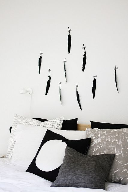 Feathers + tape = minimalistic natural decor (If you spray paint the feathers neon pink it might not look natural anymore but it would definitely look cool, I think!):
