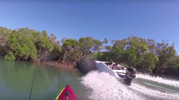 Watch a dude crash his speedboat and almost kill a kayaker