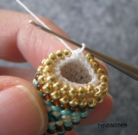 Picture 24: Continue building end until have one loop left on hook. Cut thread with two inches left and pull through the last loop to knot it in place.