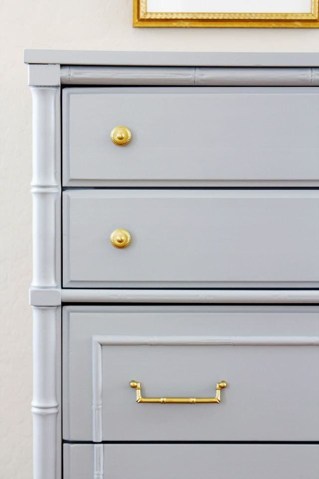 brass handles, gray dresser