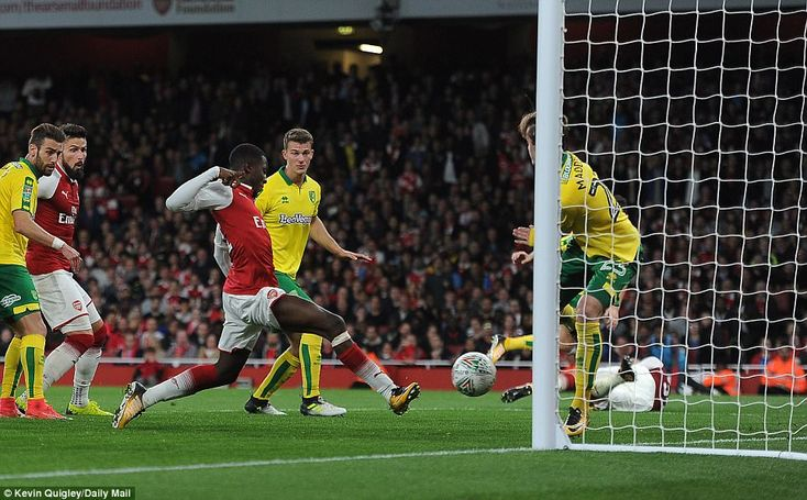 Nketiah (centre) gets on the end of Francis Coquelin's flicked header to level the scores in the closing stages of normal time