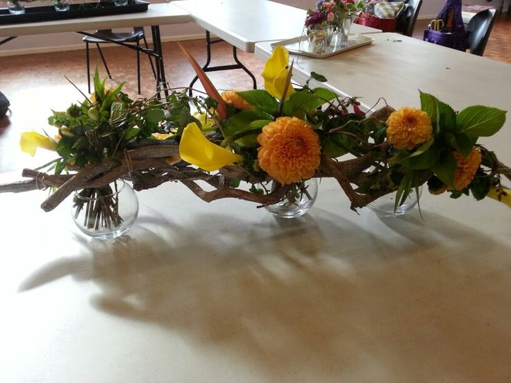 Horizontal frame decorated with tied posies.