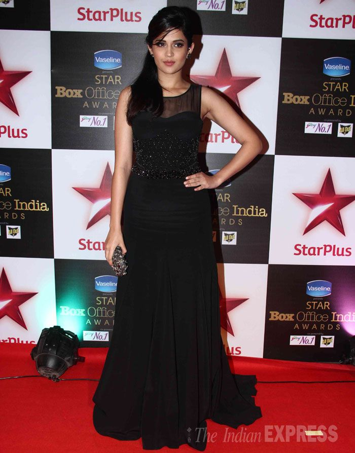 Deeksha Seth strikes a pose in a black sheer dress with a flowing bottom at STAR Box Office Awards. #Bollywood #Fashion #Style #Beauty