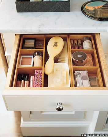 Place Dividers in the Drawers: When organizing your bathroom drawers, place dividers in them so you can maximize the small spaces and fit more into them. You can buy plastic dividers at stores like The Container Store or you can even cut up old cardboard boxes and use them.  Photo courtesy of Martha Stewart