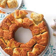 Herb and Garlic Bubble Loaf - Bubble loaf, pull-apart bread, and monkey bread are all synonyms for the same delicious combination of soft, tender bread and sweet or savory decadent coating. This version will make you think garlic knot in loaf form; it's perfect for sharing with friends.