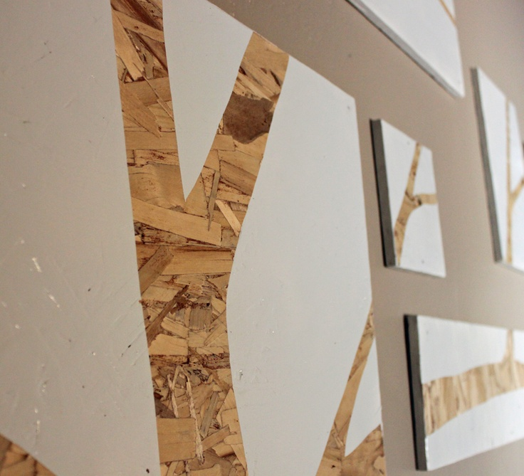 painted osb on the living room side.  osb sheets range from $8-15 per 4' x 8' sheet.