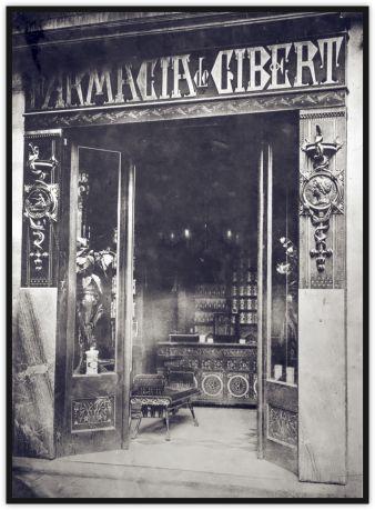 Antoni Gaudí recibió en 1879 el encargo de decorar la farmacia de Joan Gibert Casals gracias a la mediación de Eusebi Güell, que, al igual que Gibert, tenía sus orígenes familiares en la localidad tarraconense de Torredembarra. Estaba situada en el nº 4 del Paseo de Gràcia de Barcelona, lamentablemente el edificio en que estaba situada fue derruido en el año 1895, no quedando ningún rastro de la intervención de Gaudí, excepto alguna fotografia.