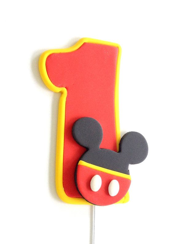 This is a bright and fun Mickey Mouse inspired fondant cake topper perfect for a birthday cake decoration. This listing includes: - A number of