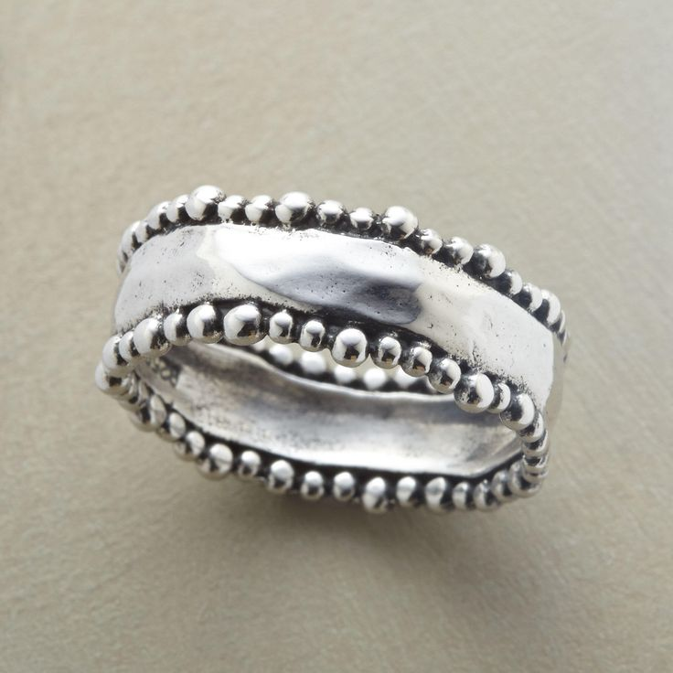 BEADED BORDERS RING -- Tiny beads parade along the wavy perimeters of our hand hammered sterling silver ring. Exclusive. Whole sizes 5 to 9.