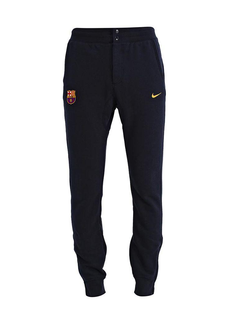 Спортивные брюки от Nike выполнены из мягкого хлопкового трикотажа синего цвета, махровая внутренняя