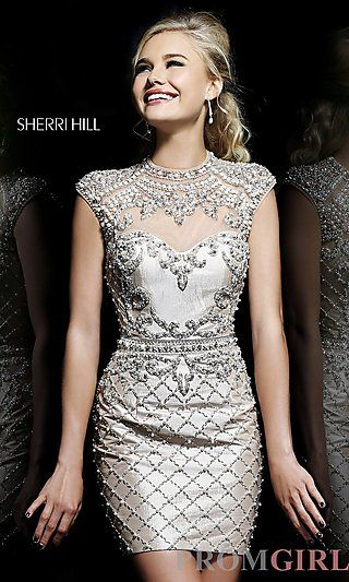 This dress is so stunning look at all the pearls and the silver color