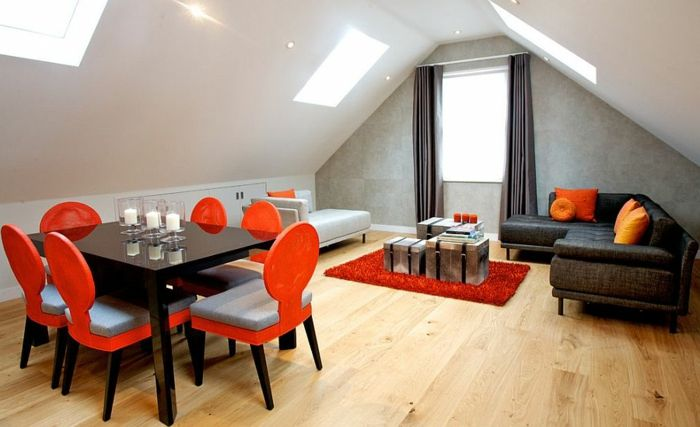 curtains ideas, attic dining room, with wooden floors, small black table, and red an pale blue chairs, sofa and window, with grey curtains