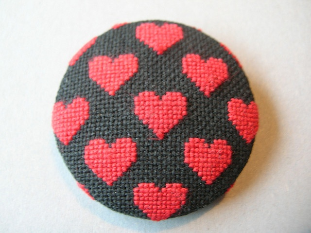 Cross stitch brooch- Red hearts/ black background by Betty Breeze, via Flickr