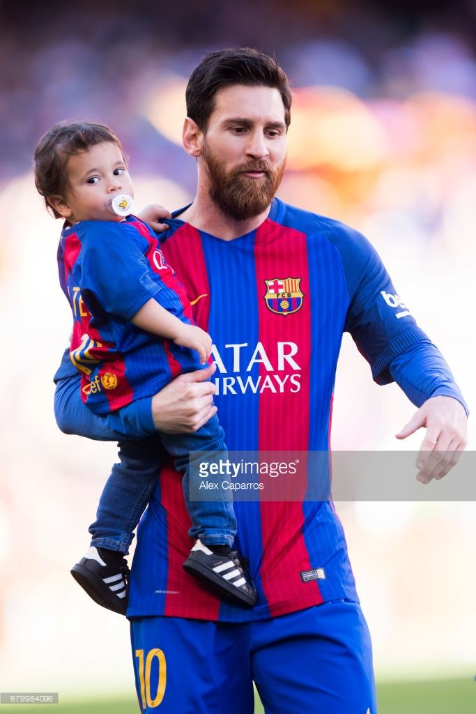 Lionel Messi of FC Barcelona carries his son Mateo Messi before the La Liga match between FC Barcelona and Villarreal CF at Camp Nou stadium on May 6, 2017 in Barcelona, Spain.