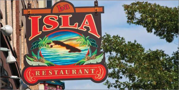 """La Isla Restaurant, 104 Washington St, Hoboken, NJ. Specialty Dishes: Papa Rellena, Tasajo Con Boniato  """"Good Cuban food makes you put a smile on your face,"""" says a diner at La Isla. It's a small place right on Washington St. in Hoboken that specializes in world-class flavors in a down-home environment. Guy stopped in and ate so much of the spicy food, his eyeballs started sweating."""