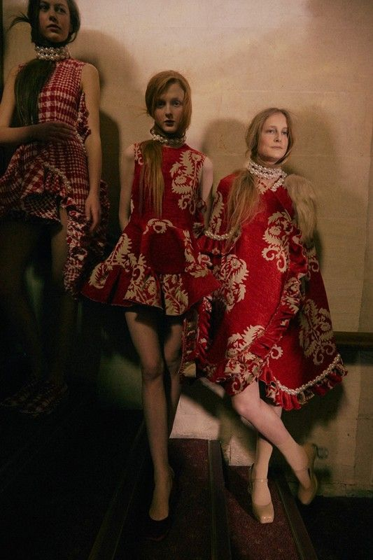Red brocade frilled sculptural dresses backstage at Simone Rocha AW15 LFW. See more here: http://www.dazeddigital.com/fashion/article/23725/1/simone-rocha-aw15-livestream