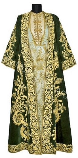The Mayor's wife's ceremonial dress. Armenian, from Karin/Erzurum, 1800-1850. The outfit is made of green silk velvet, embroidered in gold thread. Double snakes-dragons and stylized trees of life are luxuriously embroidered on the two fronts and sleeves. The inner dress is made of sky blue silk decorated with embroidered branches and baskets and edges with laces. The silk brassiere is decorated with floral motifs. (History Museum of Armenia, Yerevan).