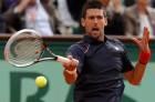Novak Djokovic of Serbia returns the ball to Andreas Seppi of Italy