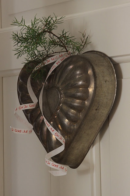 Think out of the box when displaying kitchenalia - a vintage baking tin used as a Valentine's wreath.