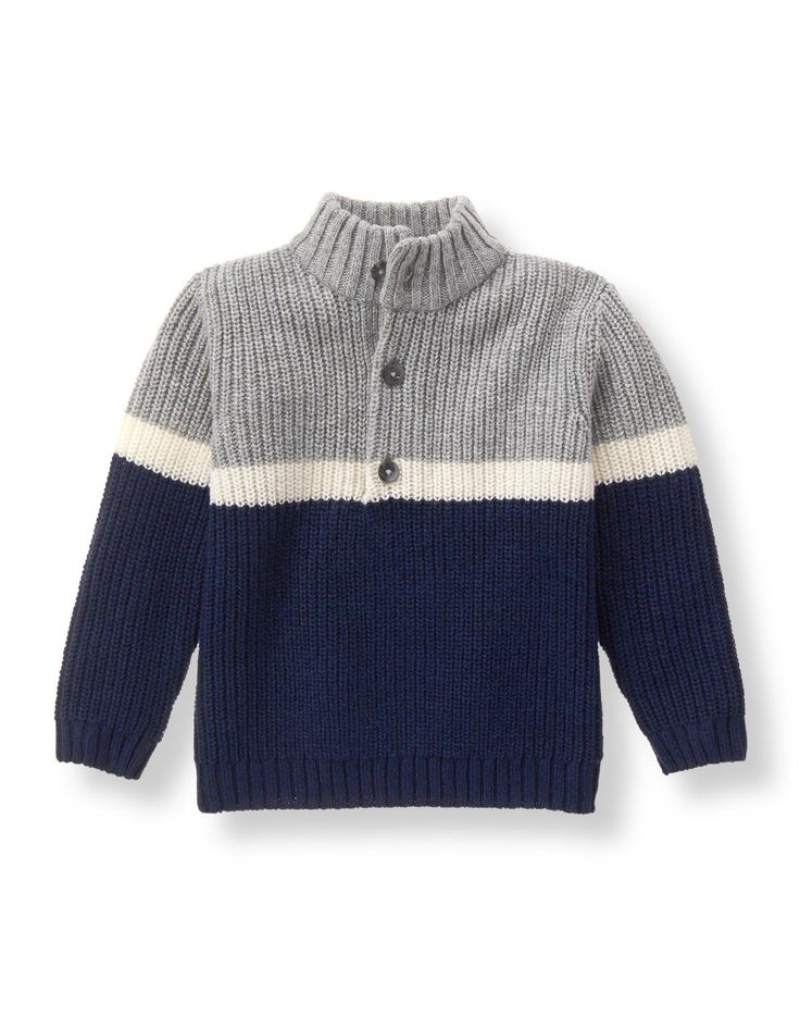 Our cozy layer features a colorblock and stripe design. Mock turtleneck style is finished with a half-button placket.
