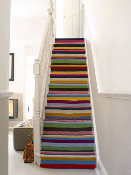 While part of what makes this so effective is that it's a cascade of color in a sea of white (and off-white) I still think it would look magnificent in my colorful front hall, hiding the worn treads of my stair.