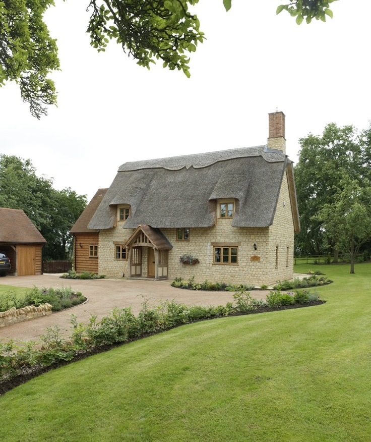 A gorgeous Border Oak thatched cottage with stone exterior and oak framed interior.
