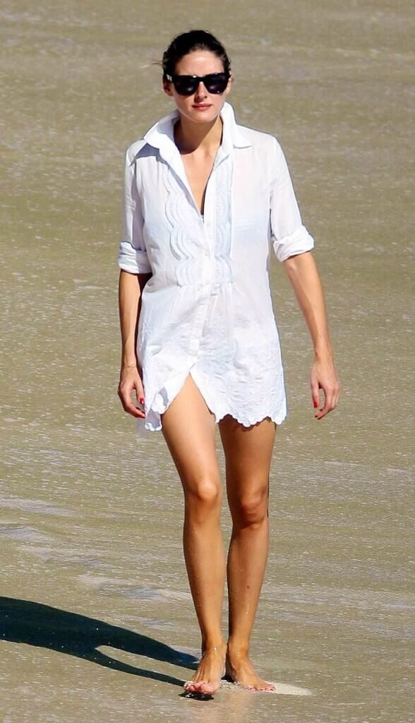 Olivia Palermo shows how to cover up at the beach: with a simple stylish white button down.