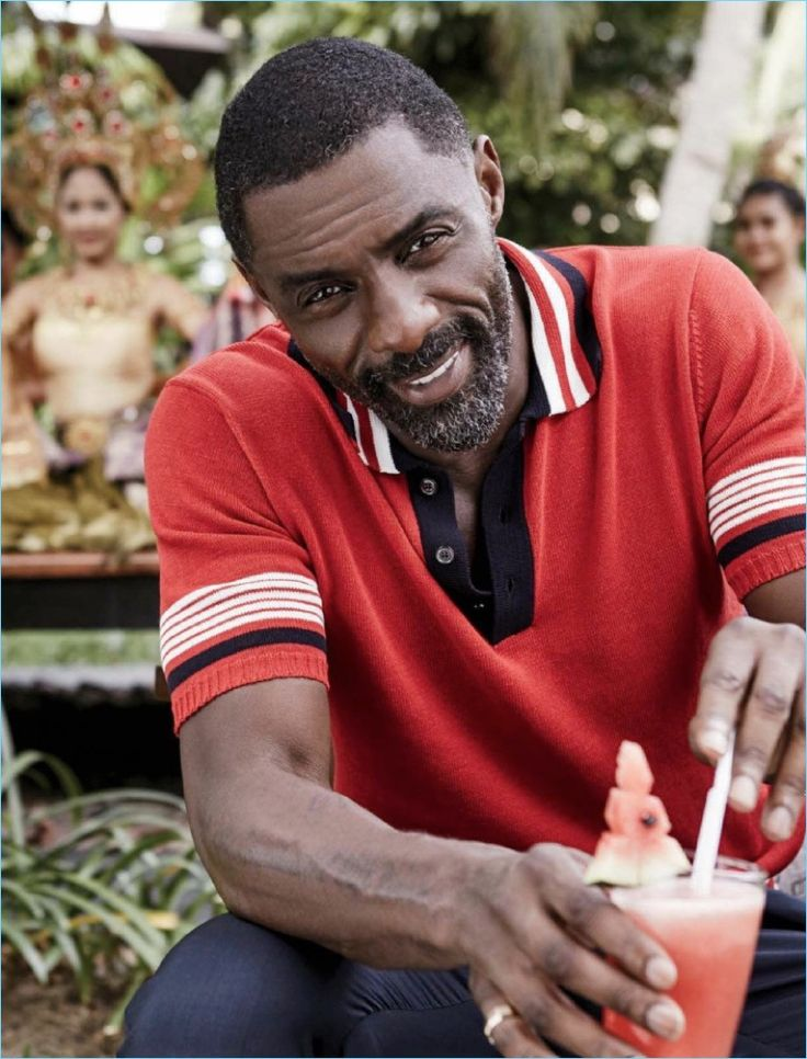 Actor Idris Elba charms in a red knit polo for the pages of Essence magazine.