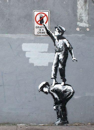 Une oeuvre de Banksy à NY, j'adore cette oeuvre car elle est impertinente et elle utilise le décor urbain
