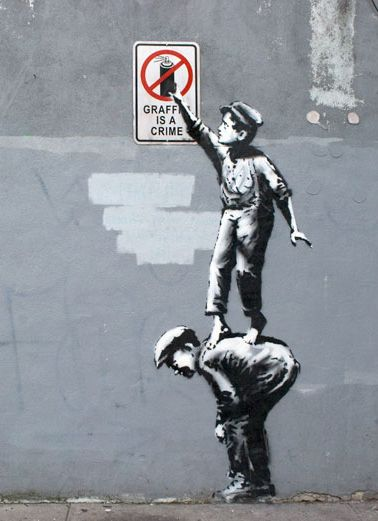 Banksy is taking what we think about graffiti and turning it upside down. What…