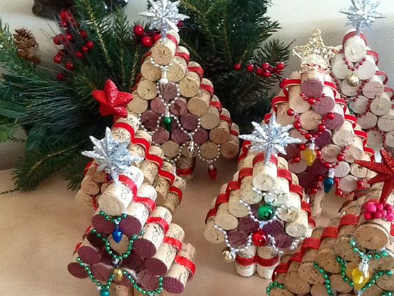 These wine cork Christmas Trees come in two different styles. One with lights (not operational) and the other with ornaments. They are approximately 6-1/4 to 7-3/4 inch high by 4-1/2 inches wide. Height of trees will vary due to different cork sizes. I consider them my small tree as there are 5 corks across on the bottom. What a cute addition to a bar, countertop or among your other holiday decorations. I can pick a style and size for you or you can specify your preference at checkout in a…