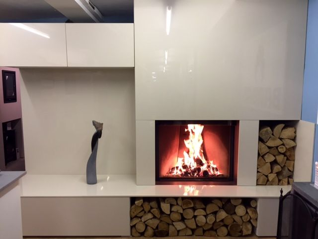Barbas Eco 80/65 Woodburning Stove with hidden guillotine door, remote control in a Lapitec Bianco Crema Lux Fireplace and cupboards.