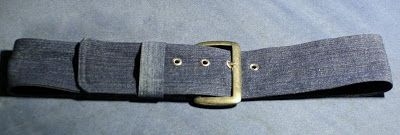 A belt made of old jeans and the hardware is from a broken belt