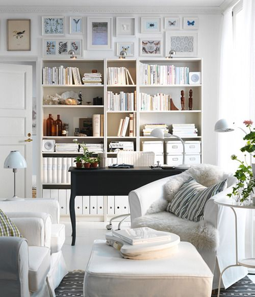 row of white gallery frames with pale blue art - my ideal home