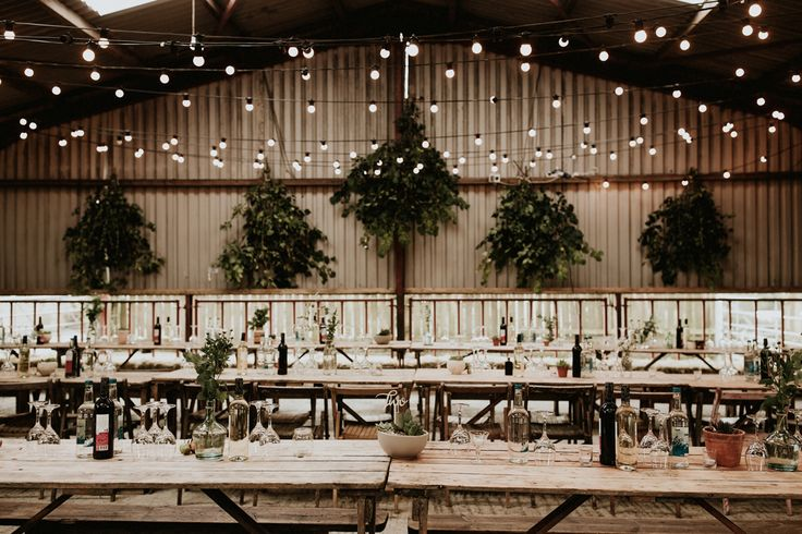 We can't believe this rustic + elegant wedding reception space is a transformed  lambing shed    Image by  Lauren Scotti Photography