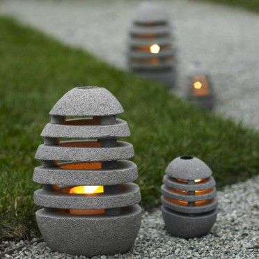 Slotted to illuminate in all directions, these oval stone lanterns open so you can insert a tealight or votive candle