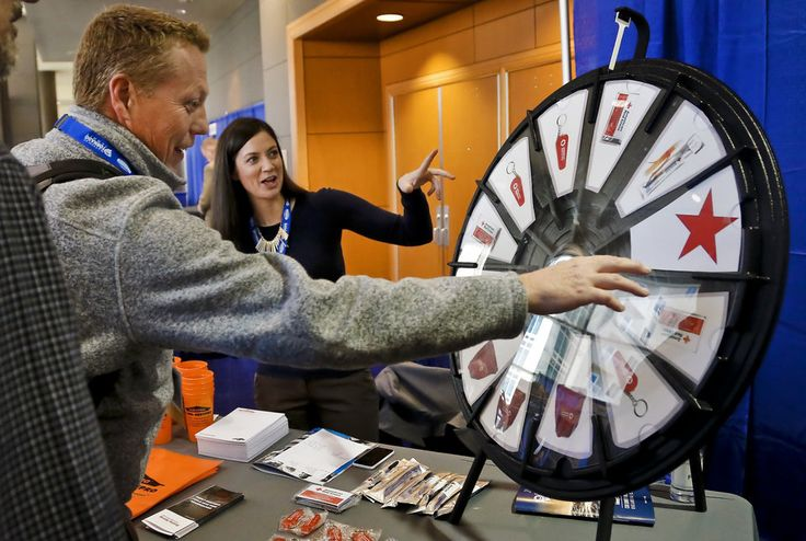 Carrie Norton of the American Red Cross has Berry Dobbs spin the prize wheel at the Red Cross vendor booth during Tuesday's National Tornado Summit at the Cox Convention Center in Oklahoma City. Read more about the Prize Wheel at https://PrizeWheel.com/blog/.