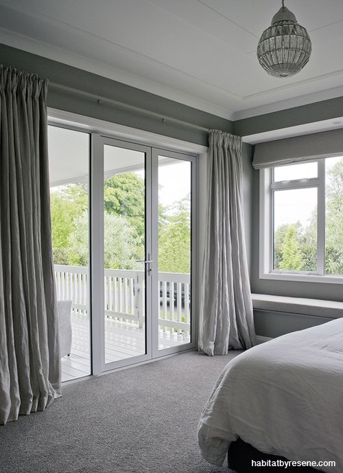 The couple wanted something a little moodier for the mainly-night time spaces and decided on Resene Taupe Grey for the master bedroom. The trims and ceiling are in Resene Rice Cake.