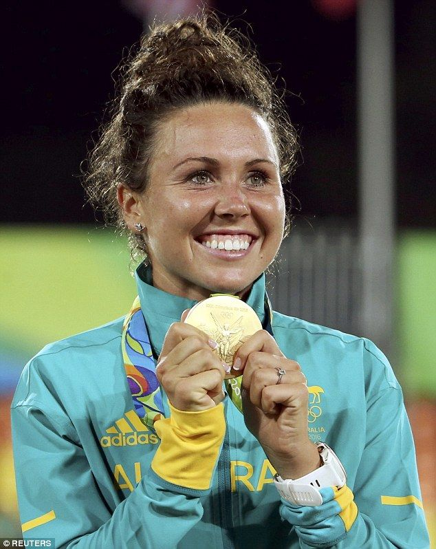 Australia's Chloe Esposito shows off her Olympic gold medal after winning the women's modern pentathlon event at the 2016 Rio Games