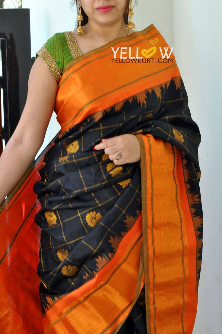 Gadwal Silk Saree in black and orange with antique gold peacock motifs .